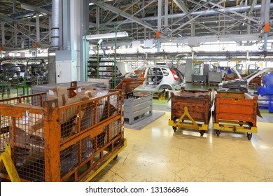TOGLIATTI - SEPTEMBER 30:Orange containers and conveyor with bodies at Avtovaz factory on September 30, 2011 in Togliatti, Russia. In November 8, 2012 in Russia sold 100000th car LADA Granta.