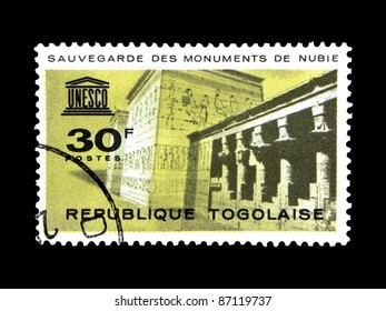 """TOGO - CIRCA 1964: A stamp printed in Togo shows the Monuments of Nubia with inscription and name of the series """" Save the Monuments of Nubia"""", circa 1964"""