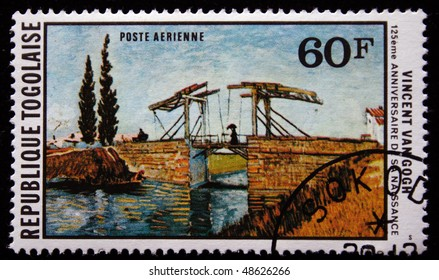 TOGO - CIRCA 1978: A stamp printed in Republic Togo shows draw by artist Vincent Van Gogh -  Drawbridges At Arles With A Group Of Washer Women, circa 1978