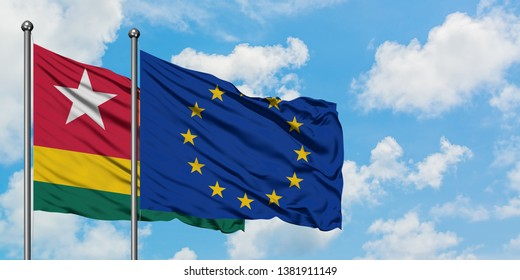 Togo and European Union flag waving in the wind against white cloudy blue sky together. Diplomacy concept, international relations.
