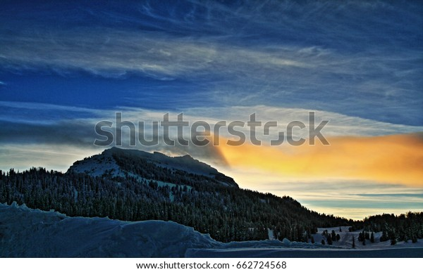 Togwotee Pass Absaroka Mountains during the winter sunset clouds in the Absaroka Mountains on Togwotee Pass between Dubois and Jackson Wyoming USA