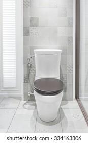 Toilet bowl in a modern bathroom.