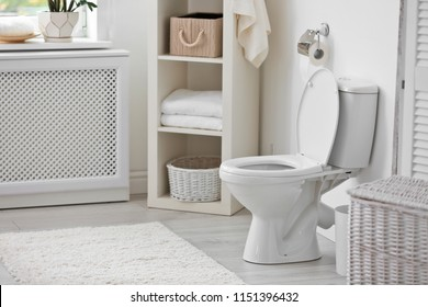 Toilet bowl in modern bathroom interior