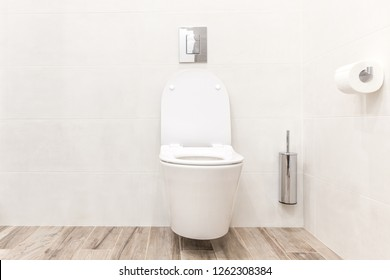 Toilet bowl in modern white style bathroom