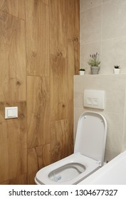 Toilet brown tones wooden texture wall .And green plants.