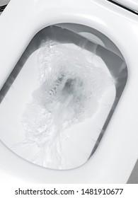 Toilet, Flushing Water, close up, flush toilet , White toilet in the bathroom, Top view of toilet bowl