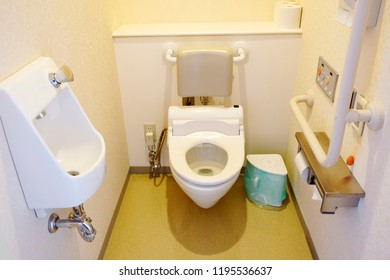 Toilet and handrail for disabled people at the toilet room in hospital, safty and medical concept