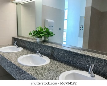 toilet interior with white sink and faucet