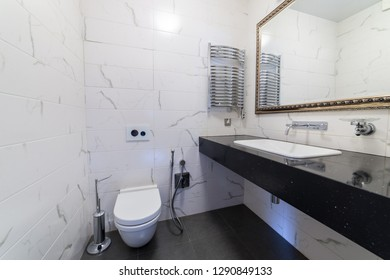 Toilet with mirror in carved frame