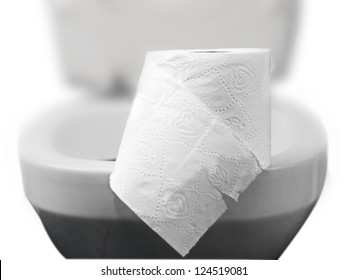toilet paper on a toilet, concept for constipation and bowel movement