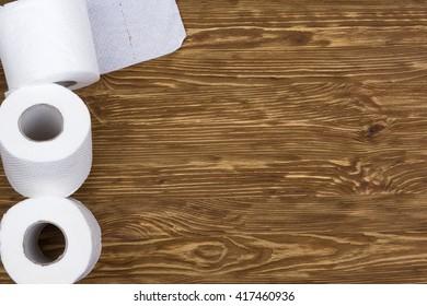 Toilet paper on wooden board
