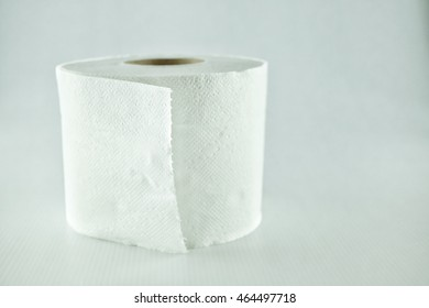Toilet paper placed on a white background.