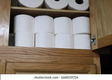 Toilet Paper reserves stockpiled on shelf