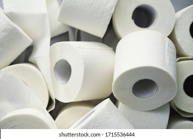 Toilet paper in a roll. Snow-white soft three-layer toilet paper. Lack hygiene products. Primary protection and disinfection.