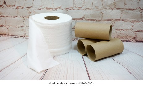 Toilet paper roll  and paper tubes on  background.