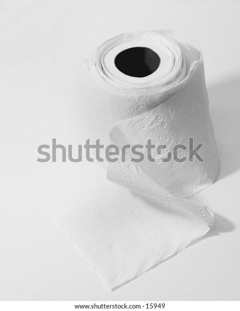 A toilet paper roll, unrolled and rolled up again, isolated on white.