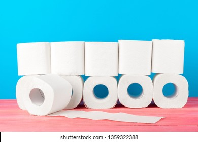 Toilet paper stack on bright blue background