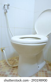 toilet room corner with open seat cover