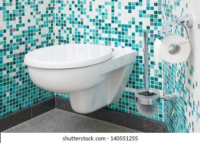 Toilet seat and paper in clean bathroom