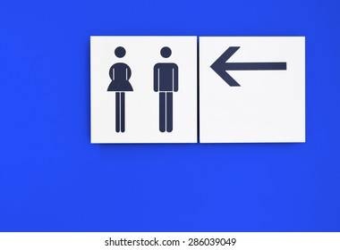 toilet sign with blue background