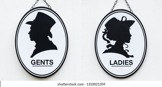 Toilet sign in vintage or classic style lady or woman and gentleman or man symbol on wall WC.