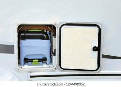 Toilet tank for the restroom inside a motorhome