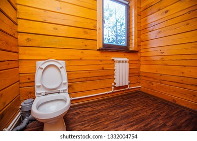 toilet in a wooden house