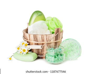 Toiletries of green color: natural soap, washcloths, shampoo, shower gel, bath salt and massager are isolated on white background