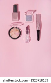 Toiletry on pink background. Beauty and fashion conception.