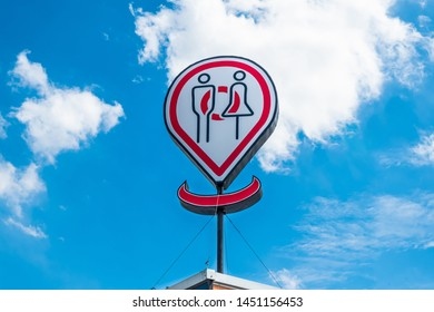 Toilets big icon or public restroom signs with female and male symbol in outdoor with blue sky background