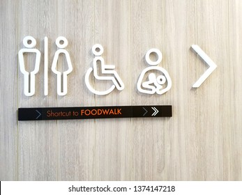 Toilets disabled symbol, baby diaper table changing station, signs shortcut to Foodwalk