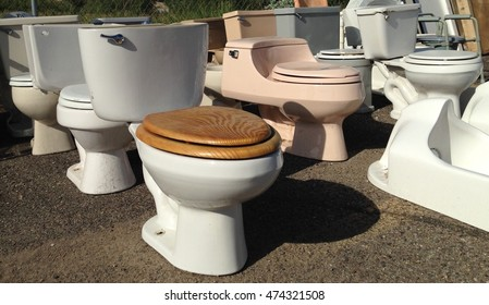 Toilets in a junkyard