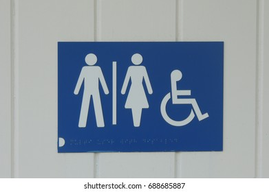 TOILETS - a sign for men, women and the disabled and wheelchairs, in Downderry, near Looe in Cornwall