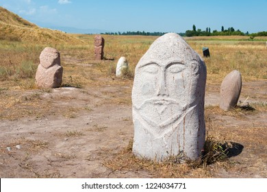 Tokmok, Kyrgyzstan - Aug 08 2018: Kurgan stelae at Ruins of Balasagun in Tokmok, Kyrgyzstan. Balasagun is part of the World Heritage Site-Silk Roads: the Routes Network of Chang'an-Tianshan Corridor.