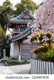 Tokushima, Japan - April 2, 2018: Cherry tree blossoming at the entrance to Anrakuji, temple number 6 of Shikoku pilgrimage