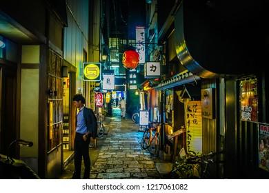 Tokyo, 6 July 2017: Night cafes in the narrow streets of Shinjuku Golden Gai. Tokyo Nightlife background. Nightlife lights at night. downtown night life scene. downtown night life scene people walking