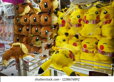 Tokyo, Akihabara/Japan - June 07, 2018: stuffed pokemon toys evoli and pikachu in a toy grabber machine
