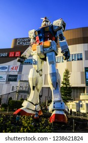 TOKYO - April 03: Gundam robot replica on April 03, 2014 in Tokyo. The sculpture is 18m tall and is the tallest replica of famous anime franchise robot, Gundam.