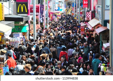 TOKYO - APRIL 1 2012: People, mostly youngsters, walk through Takeshita Dori near Harajuku train station on Sunday April 1 2012. Takeshita Dori is considered a birthplace of Japan's fashion trends.