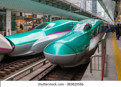 """TOKYO - APRIL 10: The green E5 Series bullet (High-speed) trains on April 10, 2013 in Tokyo. It service as """"Hayabusa(Falcon)"""" operated by JR East for Tohoku Shinkansen line (Tokyo- Shin Aomori route)."""