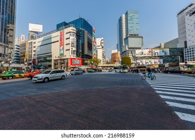 TOKYO - APRIL 10: People cross at Shibuya Intersection on April 10, 2014 in Shibuya. It's the busiest �¢??simultaneous pedestrian crosswalk�¢?�� in the world, approximately one million people each day.