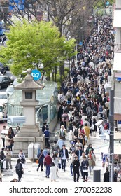 TOKYO - APRIL 11 2015: Crowds of people walking through Harajuku on Saturday April 11 2012. Harajuku is known internationally as a center of Japanese youth culture and fashion.