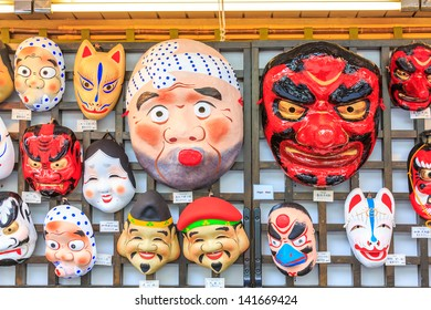TOKYO -APRIL 11: Japanese mask at souvenir shop Senso-ji Temple on April 11, 13 in Tokyo,Japan.The Senso-ji Buddhist Temple is the symbol of Asakusa and one of the most famed temples in all of Japan