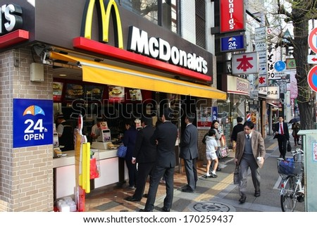TOKYO - APRIL 12: People visit McDonalds restaurant on April 12, 2012 in Tokyo. McDonald's is the 2nd most successful franchise in the world with 33,000 locations.