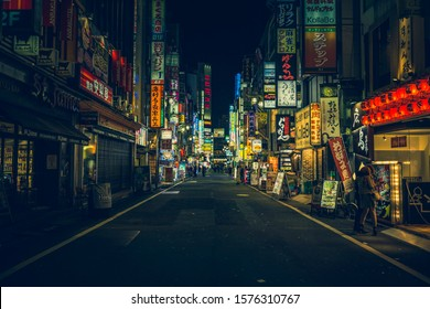 TOKYO - APRIL 13, 2017 : Color Billboards in Shinjuku's Kabuki district at night in Japan. Famous Red-light district full of bars, restaurants and night clubs in Tokyo