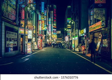 TOKYO - APRIL 13, 2017 : Color Billboards in Shinjuku's Kabuki district at night in Japan. Famous Red-light district full of bars, restaurants and night clubs in Tokyo at night