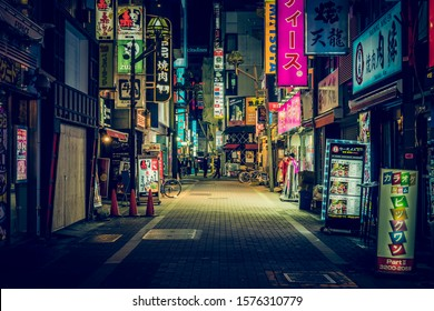 TOKYO - APRIL 13, 2017 :Color Billboards in Shinjuku's Kabuki district at night in Japan. Famous Red-light district full of bars and restaurants  in Tokyo at night