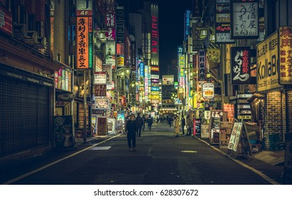 TOKYO - APRIL 13, 2017 :Color Billboards in Shinjuku's Kabuki district at night in Japan.. Famous Red-light district full of bars, restaurants and night clubs in Tokyo at night
