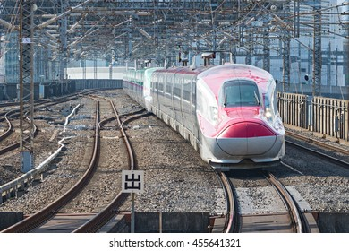 "TOKYO - APRIL 15,2016 : The Red E6 Series bullet (High-speed or Shinkansen) train in the morning. This train services as ""Komachi"" operated by JR East for Akita Shinkansen line.(Tokyo-Akita route)"