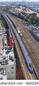 "TOKYO - APRIL 2: Top view of the E7 Series bullet train on April 2 , 2015 in Tokyo. E7 Series bullet train service as ""Kagayaki(Shine)"" for Hokuriku Shinkansen line (Tokyo - Kanazawa route)."